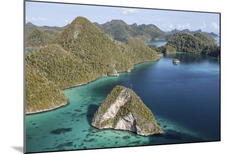 Forest-Covered Limestone Islands Surround a Lagoon in Raja Ampat-Stocktrek Images-Mounted Photographic Print