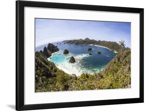 Rugged Limestone Islands Surround a Gorgeous Lagoon in Raja Ampat-Stocktrek Images-Framed Art Print