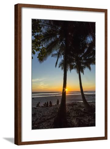 People by Palm Trees at Sunset on Playa Hermosa Beach, Santa Teresa, Costa Rica-Rob Francis-Framed Art Print
