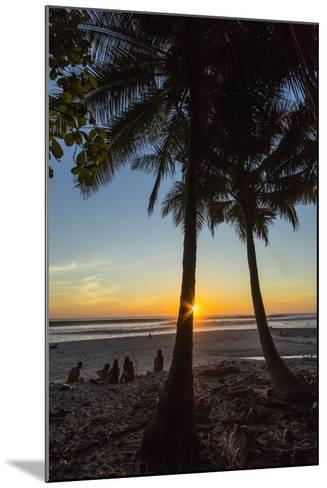 People by Palm Trees at Sunset on Playa Hermosa Beach, Santa Teresa, Costa Rica-Rob Francis-Mounted Photographic Print