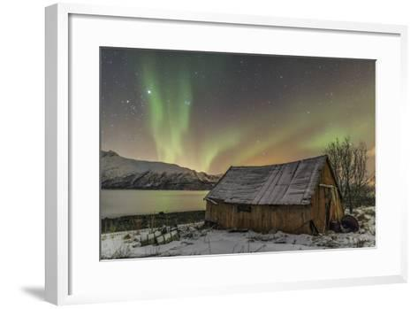 The Northern Lights Illuminates the Wooden Cabin, Svensby, Lyngen Alps, Troms, Lapland, Norway-Roberto Moiola-Framed Art Print