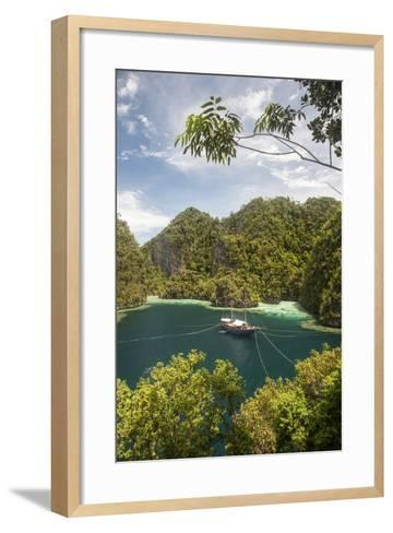 Rugged Limestone Islands Frame an Indonesian Pinisi Schooner-Stocktrek Images-Framed Art Print