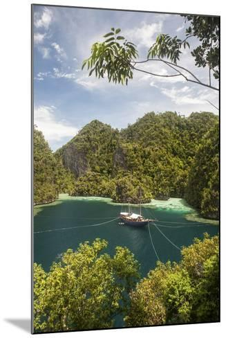 Rugged Limestone Islands Frame an Indonesian Pinisi Schooner-Stocktrek Images-Mounted Photographic Print