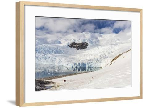 Two Hikers Surrounded by Ice-Capped Mountains and Glaciers in Neko Harbor, Polar Regions-Michael Nolan-Framed Art Print