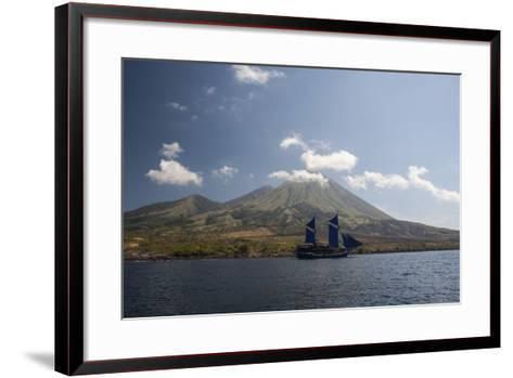 An Indonesian Pinisi Schooner Sails Near a Remote Volcanic Island-Stocktrek Images-Framed Art Print