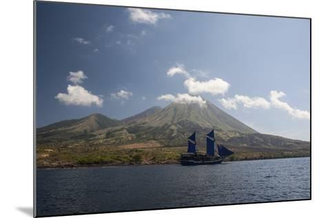 An Indonesian Pinisi Schooner Sails Near a Remote Volcanic Island-Stocktrek Images-Mounted Photographic Print