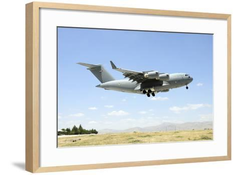 A United Arab Emirates Air Force C-17A Globemaster Iii Prepares for Landing-Stocktrek Images-Framed Art Print