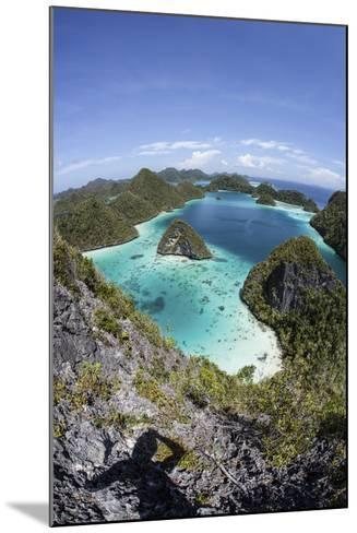Rugged Limestone Islands Surround a Gorgeous Lagoon in Raja Ampat-Stocktrek Images-Mounted Photographic Print