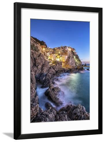 Manarola Village Illuminated by the Blue Light of Dusk with its Typical Pastel Colored Houses-ClickAlps-Framed Art Print