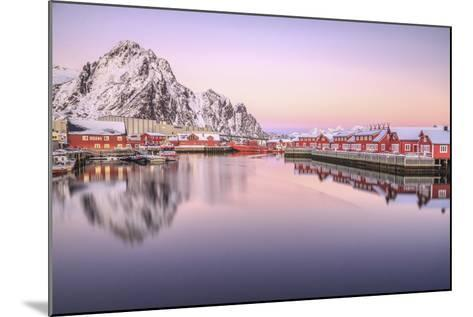 Pink Sunset over the Typical Red Houses Reflected in the Sea. Svollvaer, Lofoten Islands, Norway-ClickAlps-Mounted Photographic Print