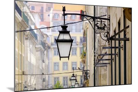 Portugal, Lisbon. Wrought Iron Street Lights on Corner of Building. Maritime Emblem-Emily Wilson-Mounted Photographic Print
