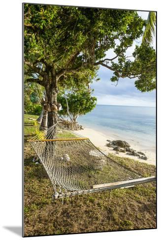 Hammock on a Beach in Ha'Apai, Tonga, South Pacific-Michael Runkel-Mounted Photographic Print