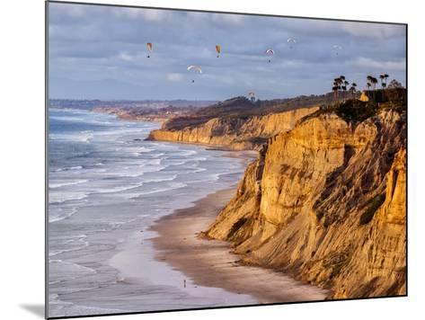 USA, California, La Jolla. Paragliders Float over Black's Beach in Late Afternoon-Ann Collins-Mounted Photographic Print