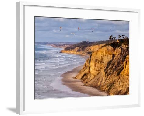 USA, California, La Jolla. Paragliders Float over Black's Beach in Late Afternoon-Ann Collins-Framed Art Print