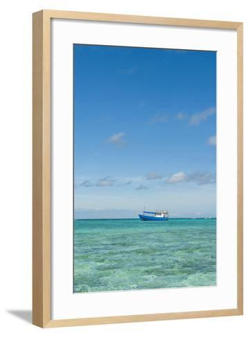 Fishing Boat in the Turquoise Waters of the Blue Lagoon, Yasawa, Fiji, South Pacific-Michael Runkel-Framed Art Print