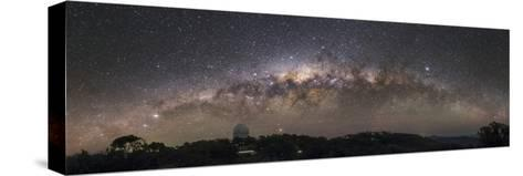 The Milky Way Arc Setting over the Siding Spring Observatory in Australia-Babak Tafreshi-Stretched Canvas Print