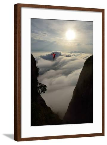 A Coastal Front Blows in While a Professional Highliner Traverses Two Cliffs-Keith Ladzinski-Framed Art Print