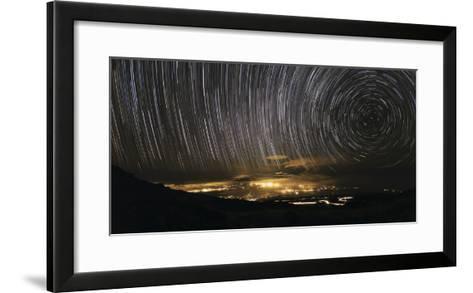 Time-Exposure Image of Star Trails Above a Town on Maui, Hawaii-Babak Tafreshi-Framed Art Print