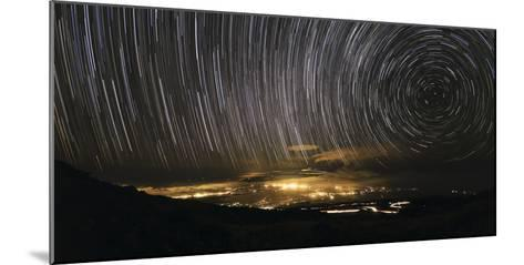 Time-Exposure Image of Star Trails Above a Town on Maui, Hawaii-Babak Tafreshi-Mounted Photographic Print