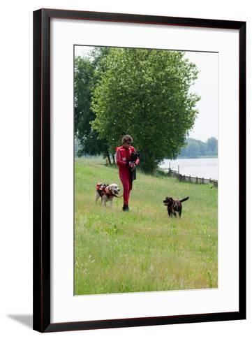 Instructors Work with Dogs Trained for Rescue at Sea Near a Lake Near Milan, Italy-Lori Epstein-Framed Art Print