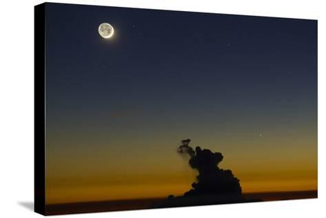 Full Moon in Sky with Colorful Twilight Horizon from the Summit of Haleakala, Hawaii-Babak Tafreshi-Stretched Canvas Print
