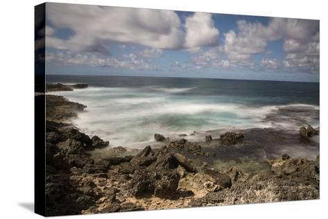 View of the Indian Ocean and Rocky Shore of a Tiny Offshore Island-Gabby Salazar-Stretched Canvas Print