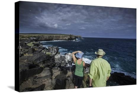 Tourists Looking Out at the Sea Cliffs of Espanola Island-Jad Davenport-Stretched Canvas Print