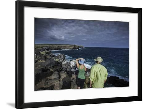 Tourists Looking Out at the Sea Cliffs of Espanola Island-Jad Davenport-Framed Art Print