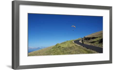 A Paraglider Soars Above a Mountain Biker-Chad Copeland-Framed Art Print