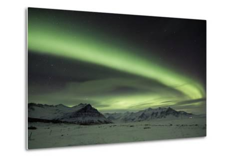 The Aurora Borealis in Iceland with Mountains in the Background-Alex Saberi-Metal Print