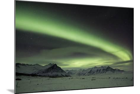The Aurora Borealis in Iceland with Mountains in the Background-Alex Saberi-Mounted Photographic Print