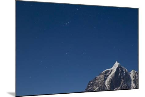 Himalayan Mountain Range Against Blue Sky with Stars at Night in the Khumbu Region-John Burcham-Mounted Photographic Print