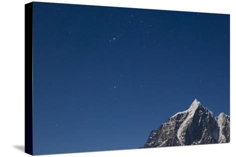 Himalayan Mountain Range Against Blue Sky with Stars at Night in the Khumbu Region-John Burcham-Stretched Canvas Print