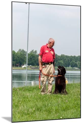 A Newfoundland Dog Trained for Rescue at Sea, with an Instructor at a Lake Near Milan-Lori Epstein-Mounted Photographic Print