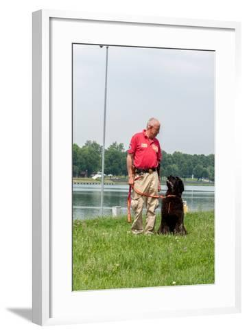A Newfoundland Dog Trained for Rescue at Sea, with an Instructor at a Lake Near Milan-Lori Epstein-Framed Art Print