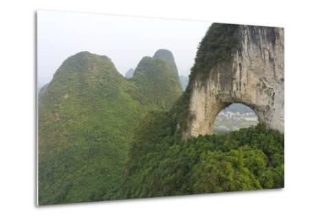 Climber on Natural Arch Formed at Moon Hill, Yangshuo, Guangxi Province, China-Chad Copeland-Metal Print