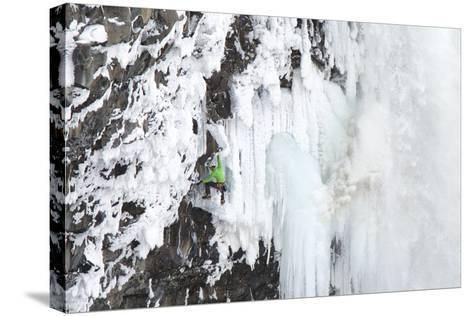 Ice Climber Tooling Ice at Helmcken Falls in British Columbia-Chad Copeland-Stretched Canvas Print