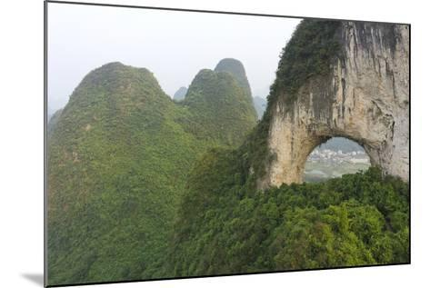 Climber on Natural Arch Formed at Moon Hill, Yangshuo, Guangxi Province, China-Chad Copeland-Mounted Photographic Print