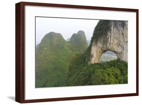 Climber on Natural Arch Formed at Moon Hill, Yangshuo, Guangxi Province, China-Chad Copeland-Framed Art Print