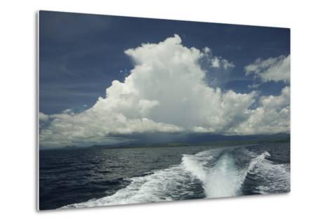 Rain Clouds over the Village of Labilabi on Halmahera Island-Timothy Laman-Metal Print
