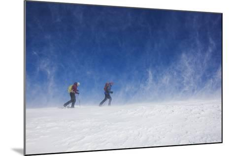 Male and Female Hiking with Snowshoes on Humphreys Peak in Flagstaff, Arizona-John Burcham-Mounted Photographic Print