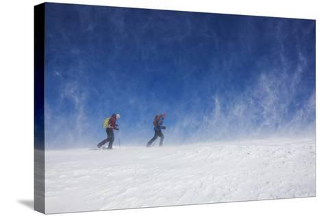 Male and Female Hiking with Snowshoes on Humphreys Peak in Flagstaff, Arizona-John Burcham-Stretched Canvas Print