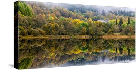 Tigh Mor Castle Peaks Out from Autumn Colors Reflected in Loch Achray Trossachs, Scotland-Jonathan Irish-Stretched Canvas Print