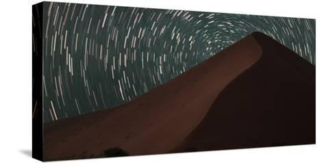 Star Trails Streak across the Sky Behind a Towering Sand Dune in the Namib Desert-Matthew Hood-Stretched Canvas Print