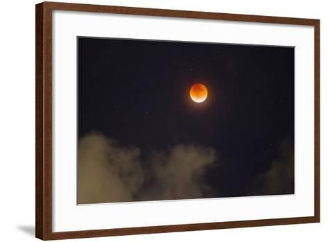 A Break in the Clouds Reveals a Rare Lunar Eclipse, also known as the Super Moon-Mike Theiss-Framed Art Print