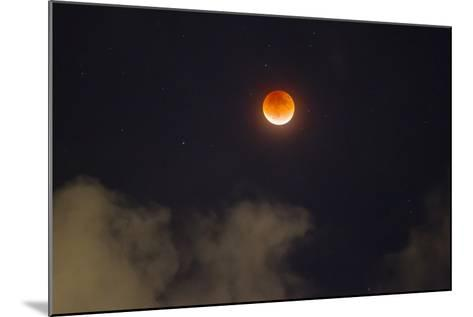 A Break in the Clouds Reveals a Rare Lunar Eclipse, also known as the Super Moon-Mike Theiss-Mounted Photographic Print