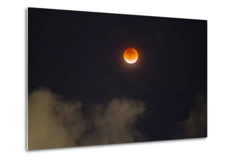 A Break in the Clouds Reveals a Rare Lunar Eclipse, also known as the Super Moon-Mike Theiss-Metal Print