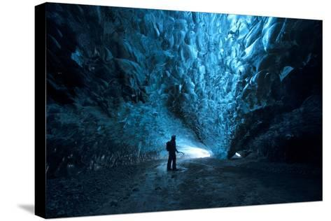 Silhouette of a Person Exploring an Ice Cave in Vatnajokull National Park, Iceland-Chad Copeland-Stretched Canvas Print