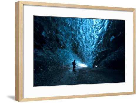 Silhouette of a Person Exploring an Ice Cave in Vatnajokull National Park, Iceland-Chad Copeland-Framed Art Print