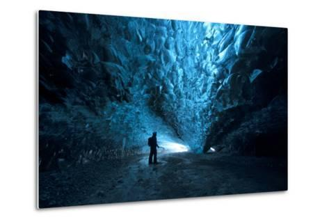 Silhouette of a Person Exploring an Ice Cave in Vatnajokull National Park, Iceland-Chad Copeland-Metal Print